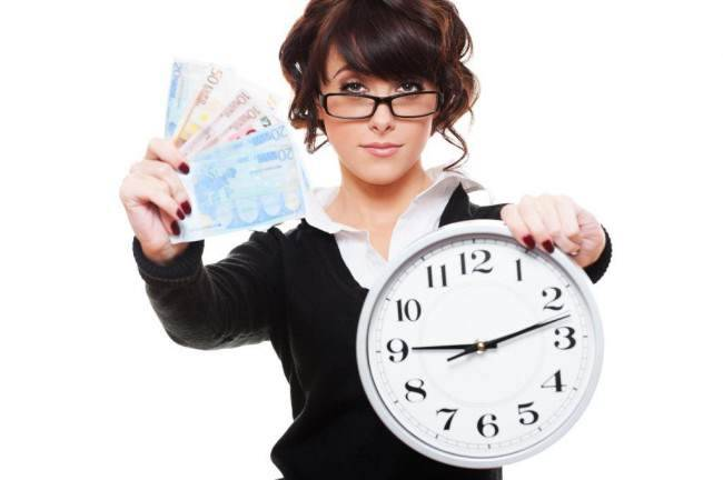 http://www.dreamstime.com/stock-images-woman-holding-money-clock-image22502014